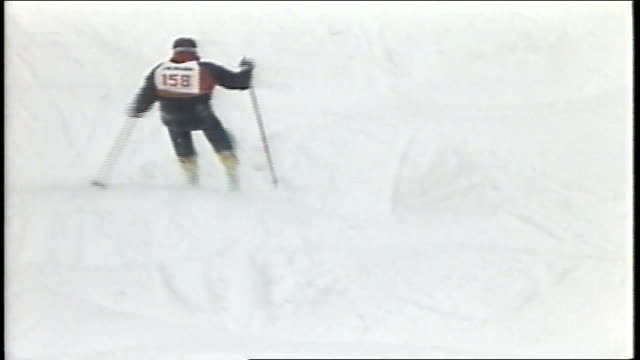 skier falling after a jump in killington, vermont - freistil skifahren stock-videos und b-roll-filmmaterial