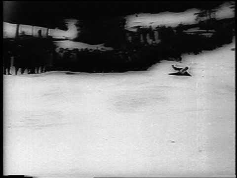 b/w 1961 skier falling down hill past camera at german alpine championships in garmisch / newsreel - falla av bildbanksvideor och videomaterial från bakom kulisserna