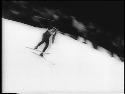 vídeos de stock, filmes e b-roll de skier going down hill + falling at german alpine championships in garmisch / newsreel - garmisch partenkirchen