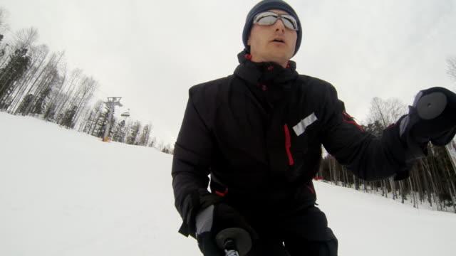 hd: skier having fun skiing - digital camcorder stock videos & royalty-free footage