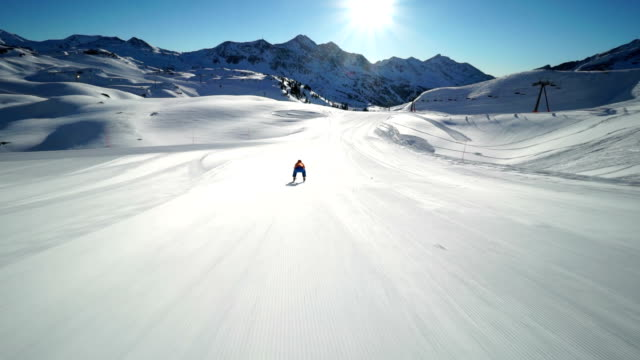 skier in downhill position on empty ski piste - following stock videos & royalty-free footage