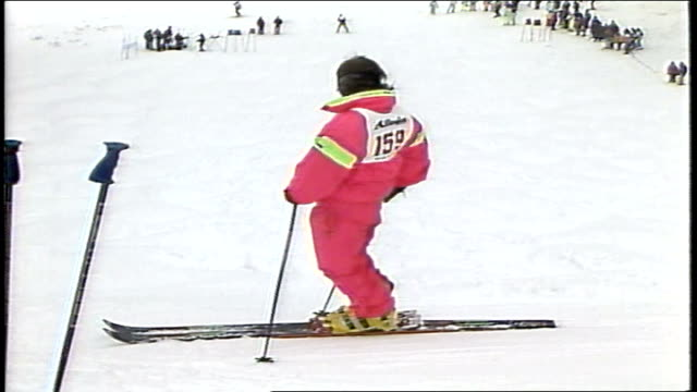 skier in pink snow suit going down hill in killington, vermont - 1980 1989 stock-videos und b-roll-filmmaterial