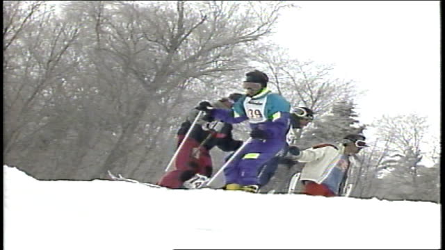 skier in purple and teal snow suit not able to get started down hill in killington, vermont - freistil skifahren stock-videos und b-roll-filmmaterial