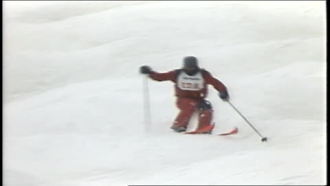 skier in red snow suit skiing down hill in killington, vermont - 1980 1989 stock videos & royalty-free footage