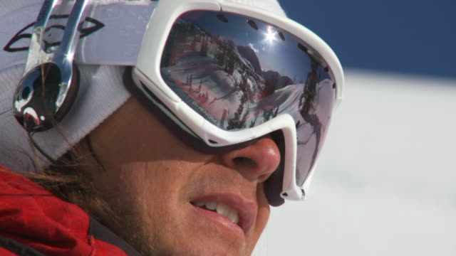 cu zo slo mo skier in skiwear getting ready to ski / alta, snowbird, utah, usa - ユタ州 アルタ点の映像素材/bロール