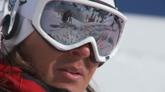 cu zo slo mo skier in skiwear looking at camera / alta, snowbird, utah, usa - skibrille stock-videos und b-roll-filmmaterial