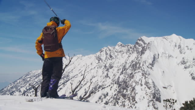 ws slo mo skier in yellow skiwear starting skiing / alta, snowbird, utah, usa - skiwear stock videos & royalty-free footage