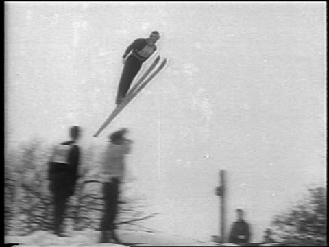 pan skier jumping in competition / chamonix france / newsreel - nordic skiing event stock videos and b-roll footage