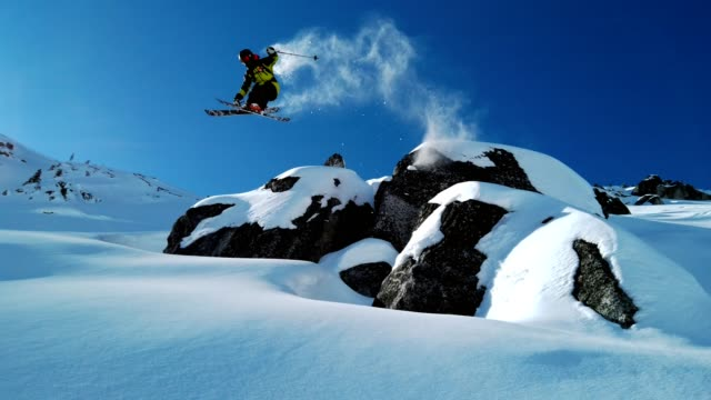 skier jumping into fresh powder - jumping stock videos & royalty-free footage