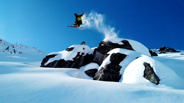 Skier jumping into fresh powder