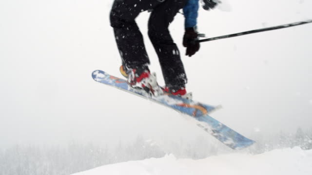 ms slo mo skier jumping over camera / squamish, bc, canada - ski clothing stock videos and b-roll footage