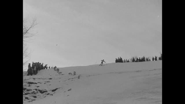 skier leaves starting banner and descends downhill / man comes off hill and lands hard, proceeds down slope / vs skier falls, tumbles / three... - bastoncino da sci video stock e b–roll
