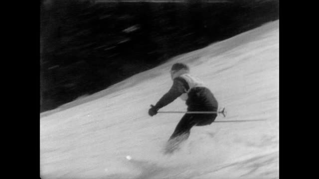 Skier makes his way downhill in the North American Alpine Ski Championships at Cannon Mountain / CU JeanClaude Killy / CU women's winner Isabelle Mir...