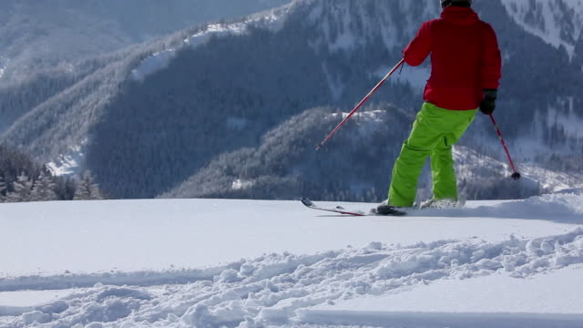 skier moving down slope - real time stock videos & royalty-free footage