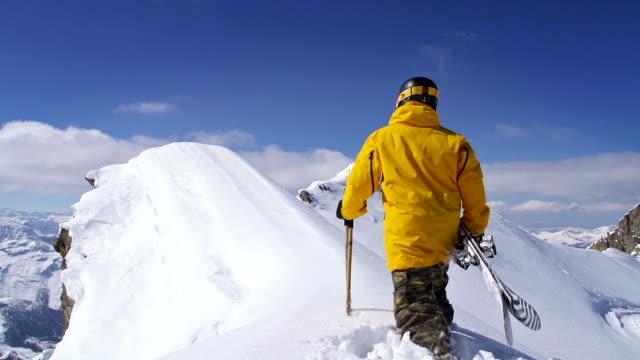 Skier on top of mountain ridge