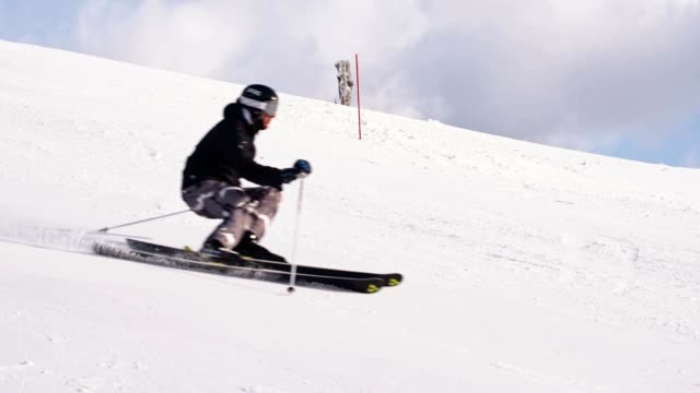 slo mo skier passing a slalom gate - steep hill stock videos & royalty-free footage
