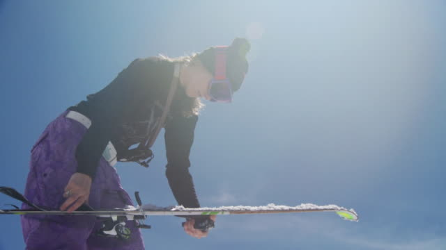 ms slo mo skier removing climbing skins from his ski / alta, snowbird, utah, usa - only mid adult women stock videos & royalty-free footage