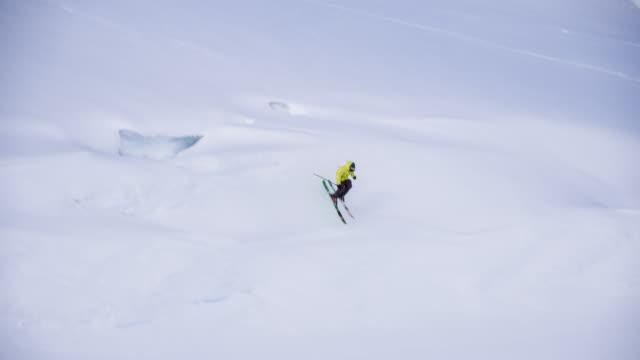 Skier riding powder snow