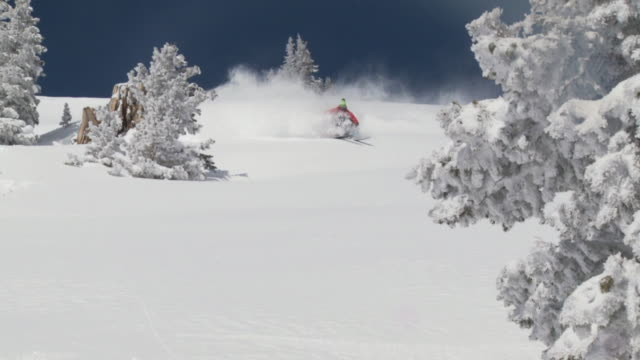 WS ZO SLO MO Skier skiing in powdery snow / Alta, Snowbird, Utah, USA