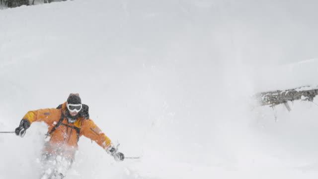 ms pan tu td pov slo mo skier skiing through trees / squamish, bc, canada - skiurlaub stock-videos und b-roll-filmmaterial