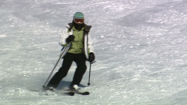 a skier slaloming downhill - ski jacket stock videos & royalty-free footage