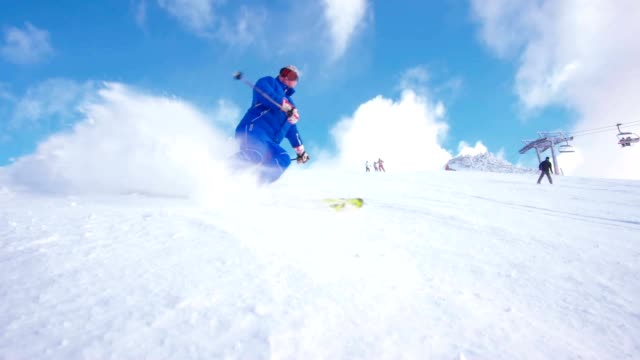 slo mo skier spraying snow at camera - steep stock videos & royalty-free footage