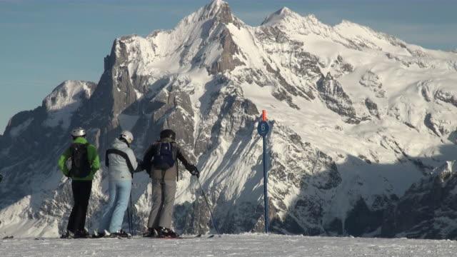 ms skier standing at mannlichen / grindelwald, bernese oberland, switzerland - ski clothing stock videos and b-roll footage