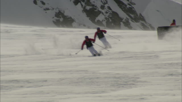 a skier stumbles and falls while racing downhill. - british columbia stock videos & royalty-free footage