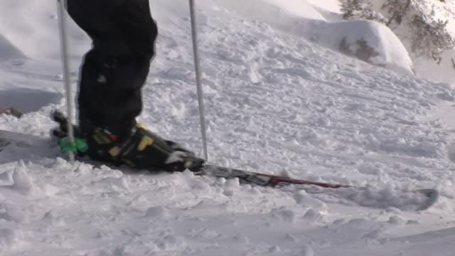 a skier traverses a snowy slope. - ski pole stock videos & royalty-free footage