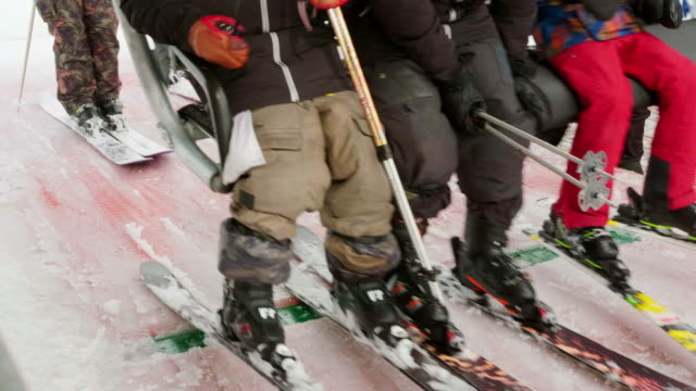 skiers and snowboarders on a ski lift - park city utah stock videos & royalty-free footage