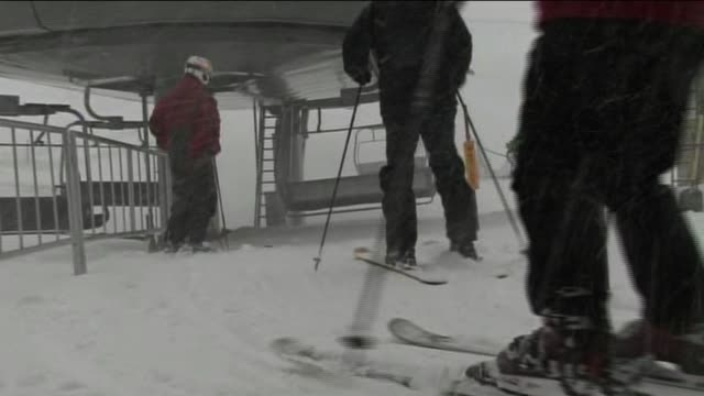 Skiers and Snowboarders Ride Ski Lift at Mammoth Mountain