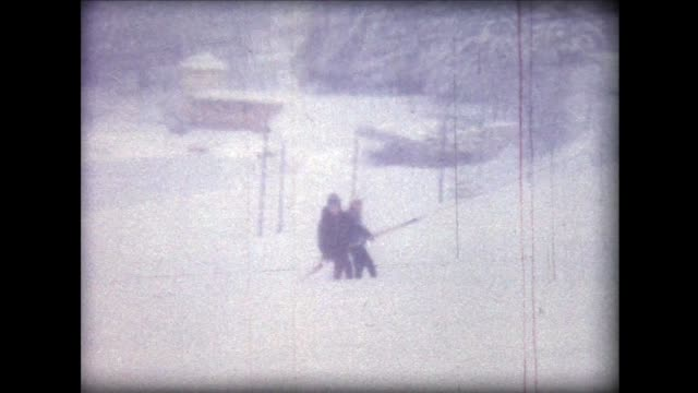 1962 skiers being pulled up on old style lift - rimorchiare video stock e b–roll