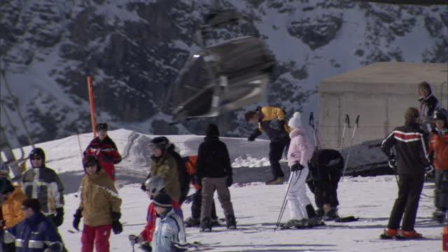 skiers enjoy snowy slopes at a mountain resort. - ski lift stock videos & royalty-free footage