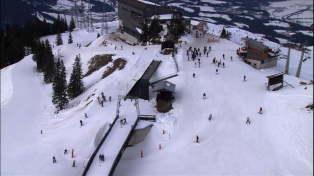 skiers enjoy the snowy slopes at a ski resort in the austrian alps. - stazione sciistica video stock e b–roll