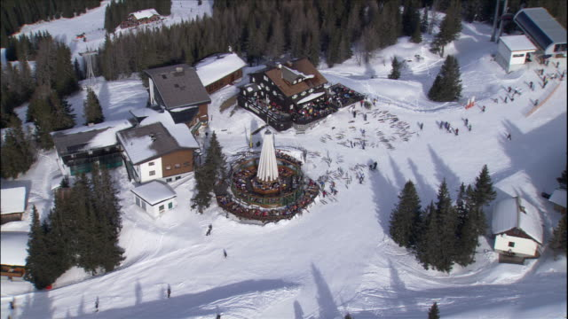 skiers gather at a ski lodge at a ski resort in austria. - ski lodge stock videos & royalty-free footage