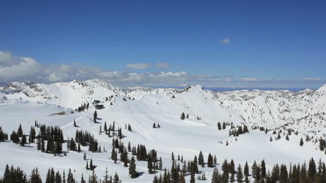 pan skiers racing down winter mountain landscape / alta, utah, united states - alta utah stock videos & royalty-free footage