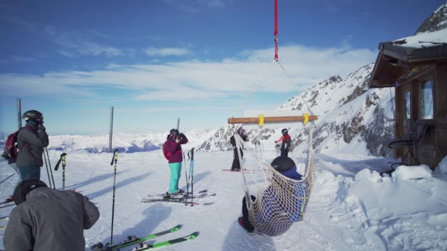 skiers relaxing at the top of la plagne ski resort, tarentaise, savoy, french alps, france, europe - ski resort stock videos & royalty-free footage