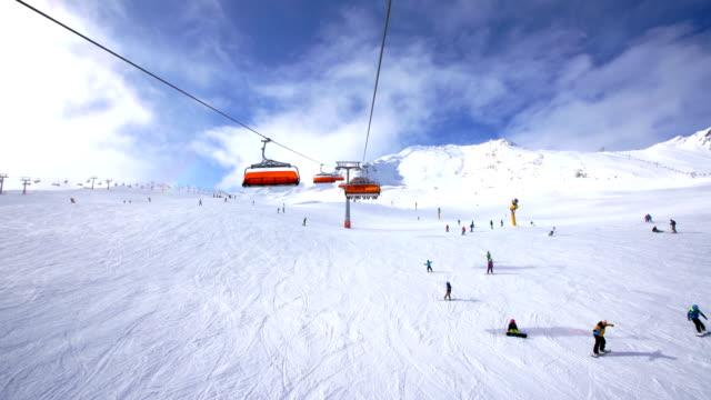 Skiers skiing at winter ski resort Soelden, Tirol, Austria