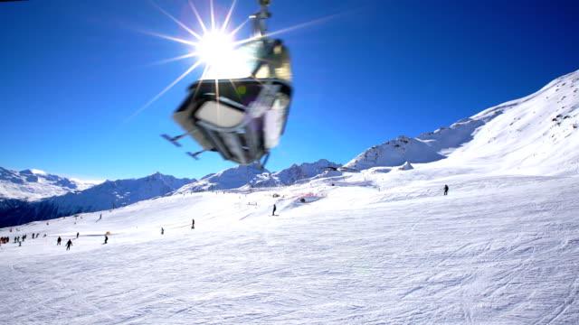 skiers skiing at winter ski resort soelden, tirol, austria - inquadratura dalla sciovia video stock e b–roll