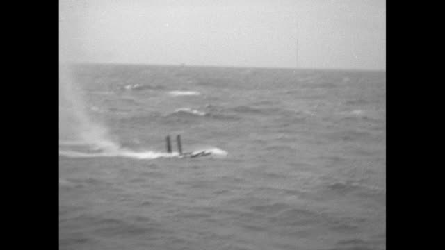 skiff approaches a portion of a ship above the water; men row with an explosion behind them in the distance / a heavy gun firing on the vessel / the... - cayuga stock videos & royalty-free footage