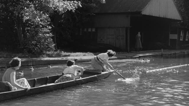 1956 montage skiff rower falling into river / united kingdom - misfortune stock videos & royalty-free footage