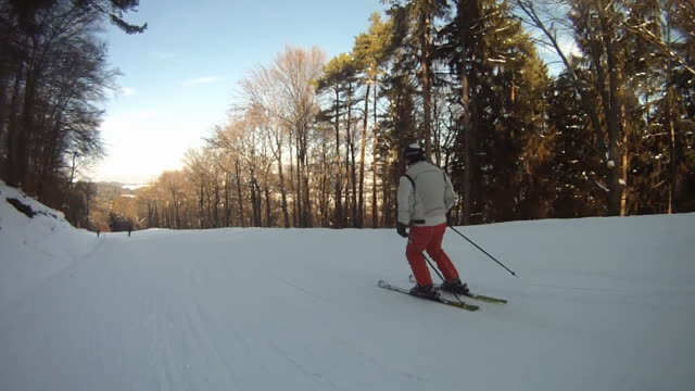 HD: Skiing Along Ski Slope