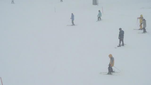 skiing and snowboarding at gala yuzawa ski resort, niigata, japan - snowing stock videos & royalty-free footage