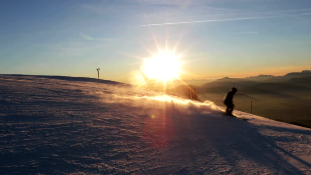 skiing at sunset - ski slope stock videos & royalty-free footage