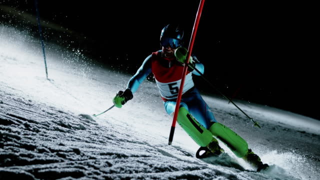 SLO MO A skiing competitor on the track at a night slalom race
