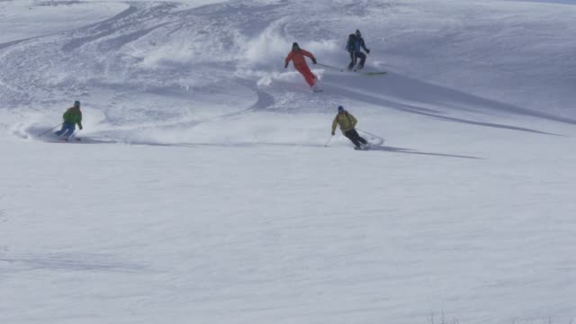 skiing deep snow powder down mountain - skiing and snowboarding stock videos and b-roll footage