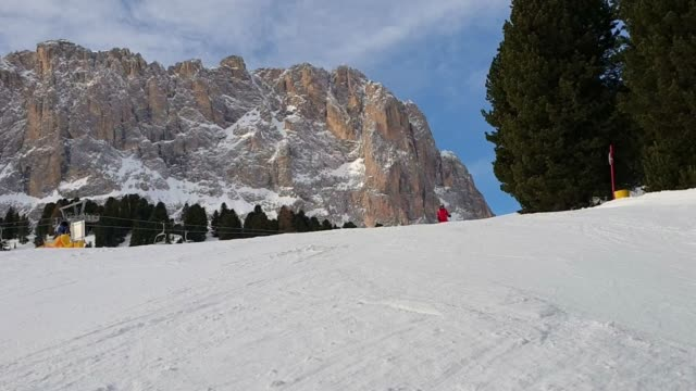 skiing downhill in dolomites - downhill skiing stock videos & royalty-free footage