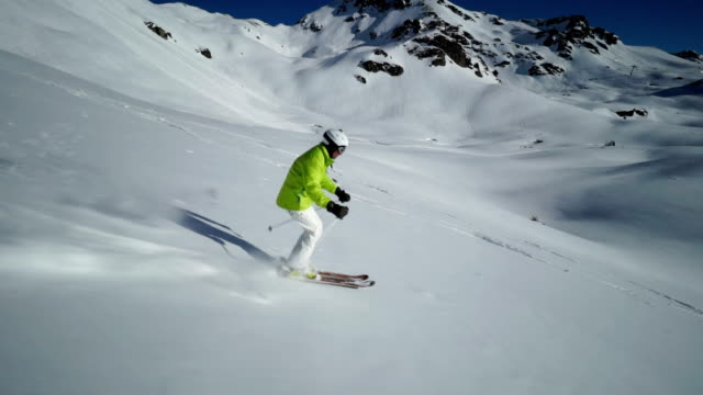 skiing off piste on sunny winter day - ski jacket stock videos and b-roll footage