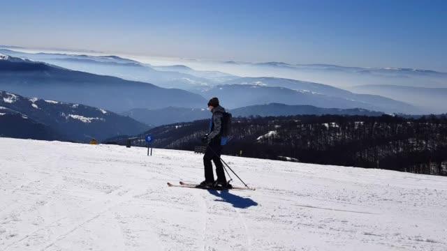 skiing snow powder down mountain - ski jacket stock videos & royalty-free footage