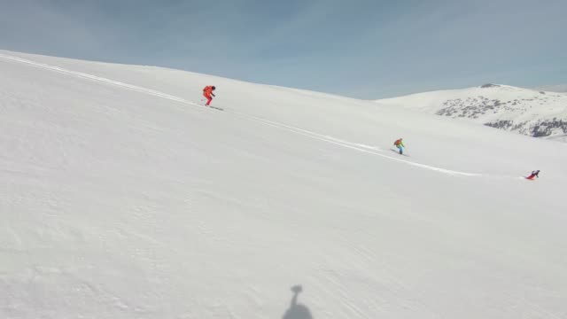 skiing snow powder down mountain - skiing and snowboarding stock videos and b-roll footage